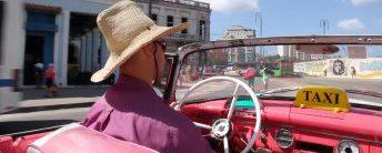 Dirver in a convertible car in Havana